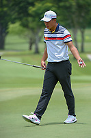 Yuxin LIN (CHN) reacts after barely missing his putt on 11 during Rd 4 of the Asia-Pacific Amateur Championship, Sentosa Golf Club, Singapore. 10/7/2018.<br /> Picture: Golffile | Ken Murray<br /> <br /> <br /> All photo usage must carry mandatory copyright credit (© Golffile | Ken Murray)