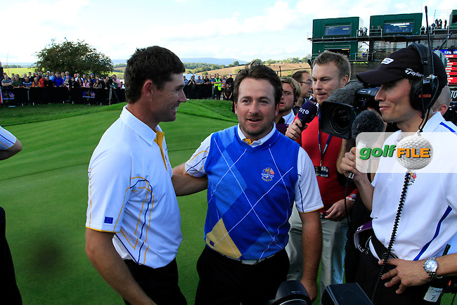 Padraig Harrington and Graeme McDowell celebrate after Europe winning on the 18th green after the Singles Matches during the Final Day of the The 2010 Ryder Cup at the Celtic Manor, Newport, Wales, 3rd October 2010..(Picture Eoin Clarke/www.golffile.ie)