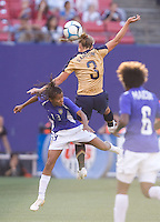 Christie Rampone leaps over Grazielle to win a header. USA defeated Brazil 2-0 at Giants Stadium on Sunday, June 23, 2007.