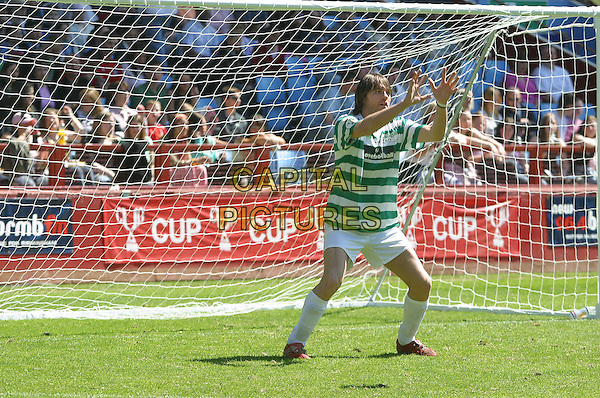 BRIAN McFADDEN<br /> 10th Annual Music Industry Soccer Six Tournament,<br /> Aston Villa, Birmingham, May 15th 2005.<br /> full length football kit pitch greeen white stripes striped shorts socks Bryan hands up goal goalie funny<br /> Ref: JEZ<br /> www.capitalpictures.com<br /> sales@capitalpictures.com<br /> &copy;Jez Self/Capital Pictures
