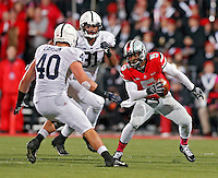 Ohio State Buckeyes quarterback Braxton Miller (5) tries to get past Penn State Nittany Lions linebacker Glenn Carson (40) in the 2nd quarter at Ohio Stadium on October 26, 2013.  (Dispatch photo by Kyle Robertson)