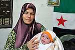 Khadoug Sawady, a Syrian refugee, holds her infant daughter Sajida Jallol in the village of Lala in Lebanon's Bekaa Valley. The woman received a baby kit provided by International Orthodox Christian Charities, a member of the ACT Alliance which is assisting Syrian refugees in Lebanon in a variety of ways..