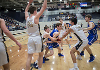 NWA Democrat-Gazette/CHARLIE KAIJO Rogers High School Elliot Paschal (11) protects the ball during a basketball game, Friday, January 11, 2019 at Wolverine Arena at Bentonville West in Centerton.