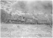 RGS 4-6-0 #20 with post-movie tender paint pulling freight.<br /> RGS