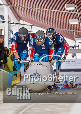 9 January 2016: Russian pilot Alexey Stulnev leads his 4-man team as they push off their first run of the day at the BMW IBSF World Cup Bobsled Championships at the Olympic Sports Track in Lake Placid, New York, USA. Stulnev's team came in 7th for the day, with a 2-run combined time of 1:50.42. Mandatory Credit: Ed Wolfstein Photo *** RAW (NEF) Image File Available ***