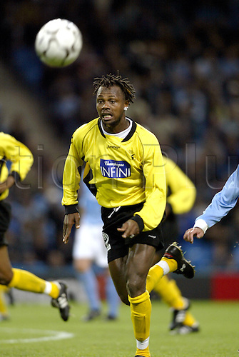 September 24, 2003: Lokeren's LEZOU DOBA runs with the ball during the first leg of Manchester City's First Round UEFA Cup game against Sporting Lokeren played at the City of Manchester Stadium. Manchester City 3 v LOKEREN 2 Photo: Glyn Kirk/action plus<br />