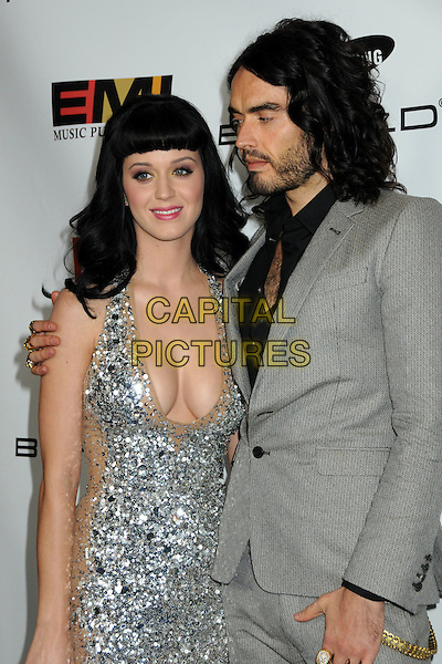 KATY PERRY & RUSSELL BRAND.EMI Post Grammy Party 2010 held at the W Hollywood Hotel, Hollywood, California, USA, 31st January 2010..half length silver sequined sequin beige cleavage beard facial hair  halterneck dress grey gray suit black shirt couple grammys  profile .CAP/ADM/BP.©Byron Purvis/Admedia/Capital Pictures