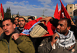 Palestinians carry the body of Ahmad Daragma, 21, during his funeral in the West Bank Town of Tubas, near Jenin City, on 02 January 2011. Israeli soldiers shot dead Daragma at the Hamra checkpoint east of Nablus in the northern West Bank, the Israeli military and medics said. Photo by Wagdi Eshtayah
