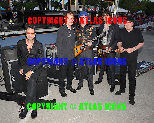 SUNRISE FL - JULY 04:  Cy Curnin, Rupert Greenall, Dan K. Brown, Jamie West-Oram and Adam Woods of The Fixx pose backstage during the City of Sunrise 4th of July Celebration held at  the BB&T Center on July 4, 2015 in Sunrise, Florida. (Photo by Larry Marano © 2015
