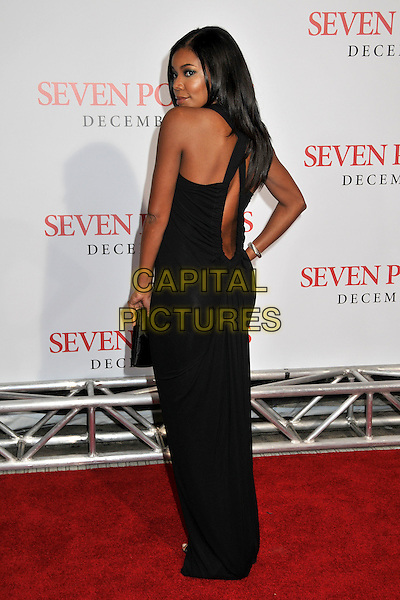 "GABRIELLE UNION.""Seven Pounds"" Los Angeles Premiere at Mann's Village Theatre, Westwood, California, USA..December 16th, 2008.full length black dress hand on hip clutch bag long looking over shoulder .CAP/ADM/BP.©Byron Purvis/AdMedia/Capital Pictures."