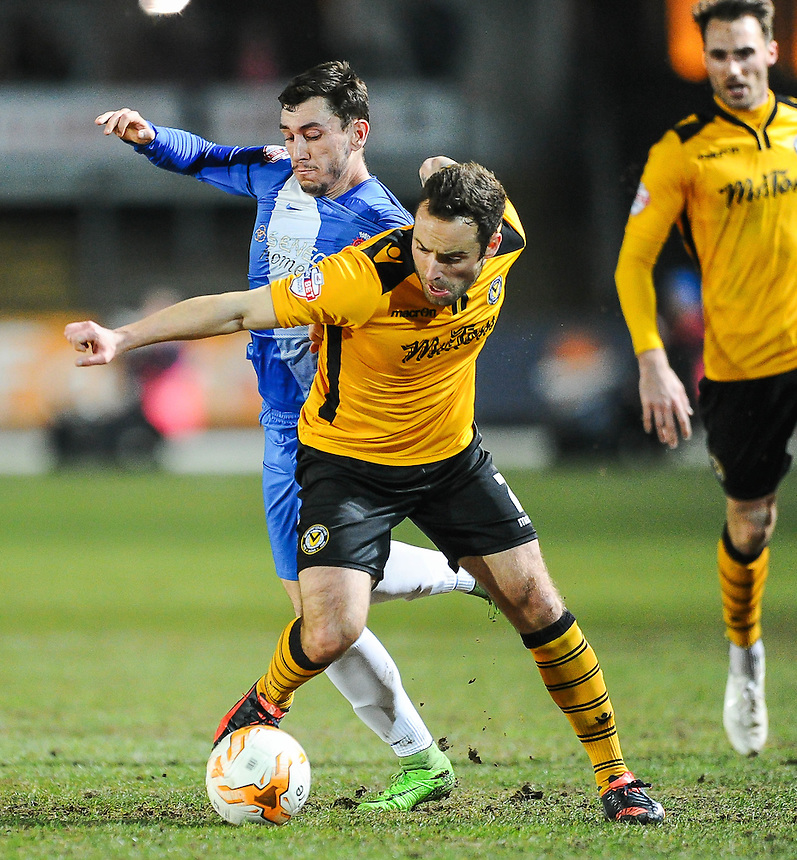 Newport County's Danny Holmes holds off the challenge from Hartlepool United's Nathan Thomas<br /> <br /> Photographer Craig Thomas/CameraSport<br /> <br /> Football - The Football League Sky Bet League Two - Newport County v Hartlepool United - Tuesday 15th March 2016 - Rodney Parade - Newport<br /> <br /> &copy; CameraSport - 43 Linden Ave. Countesthorpe. Leicester. England. LE8 5PG - Tel: +44 (0) 116 277 4147 - admin@camerasport.com - www.camerasport.com