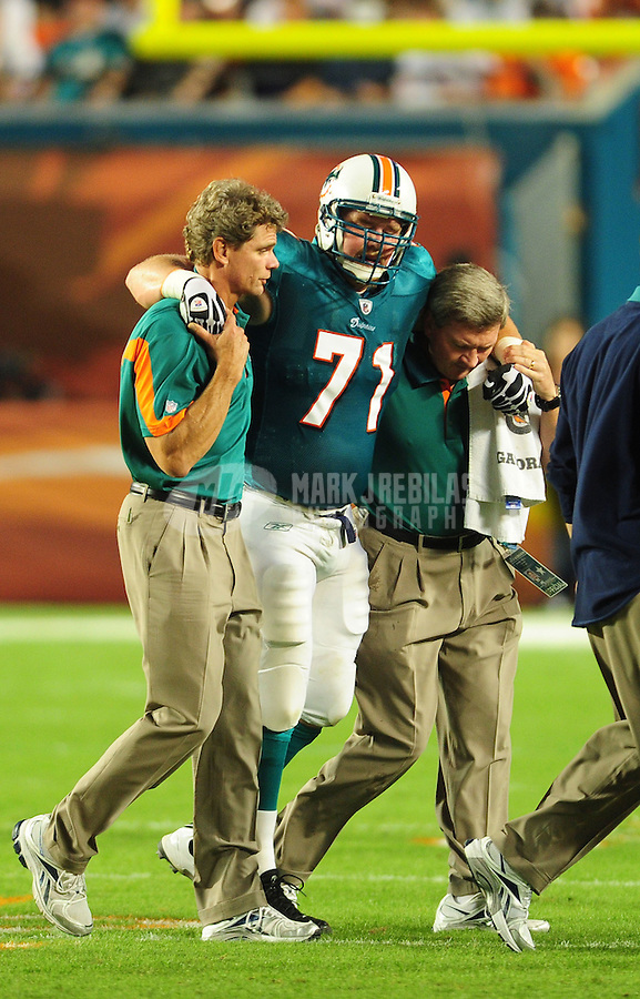 Nov. 18, 2010;  Miami, FL, USA; Miami Dolphins guard (71) Cory Procter is helped off the field after suffering an injury against the Chicago Bears at Sun Life Stadium. Mandatory Credit: Mark J. Rebilas-