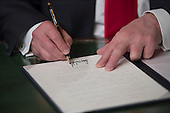 United States President Donald Trump formally signs his cabinet nominations into law, Friday, Jan. 20, 2017, in the President's Room of the Senate on Capitol Hill in Washington. <br /> Credit: J. Scott Applewhite / Pool via CNP