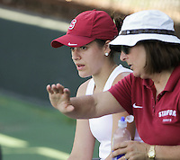 STANFORD, CA - April 1, 2011:  Nicole Gibbs gets some instruction from Head Coach Lele Farood during Stanford's 6-1 victory over Arizona State at Stanford, California on April 1, 2011.