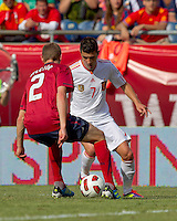 Spain forward David Villa (7) dribbles as USA defender Jonathan Spector (2) defends. In a friendly match, Spain defeated USA, 4-0, at Gillette Stadium on June 4, 2011.
