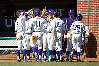 Spencer Angelis (11) of the High Point Panthers is congratulated by teammates after scoring a run against the LIU-Brooklyn Blackbirds at Willard Stadium on March 8, 2015 in High Point, North Carolina.  The Panthers defeated the Blackbirds 9-0.  (Brian Westerholt/Four Seam Images)