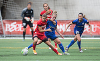 Seattle, WA - Saturday Aug. 27, 2016: Tobin Heath, Meleana Shim, Kim Little, Rumi Utsugi during a regular season National Women's Soccer League (NWSL) match between the Seattle Reign FC and the Portland Thorns FC at Memorial Stadium.