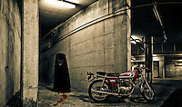 Bloody zombie and motorcycle in parking garage