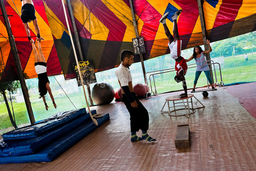 """Students perform acrobatics and gymnastics during the lessons in the circus school Circo para Todos in Cali, Colombia, 28 June 2014. Circo Para Todos (""""Circus for All""""), founded by Felicity Simpson, a former British circus performer, is the first professional circus school in the world specifically dedicated to disfavoured kids and talented street children. Students are trained in a range of circus art skills including acrobatics, balancing, juggling, stilt walking or unicyling. After finishing the four-year course, graduates may find jobs in circuses in the world or in the cruise ships."""