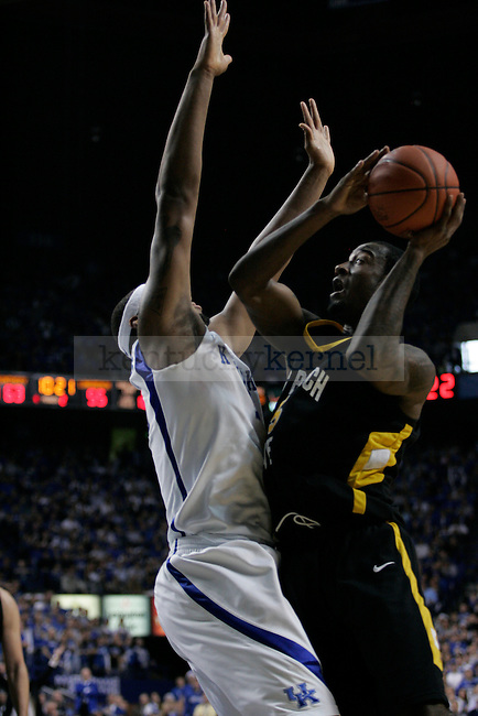Freshman forward DeMarcus Cousins guards T.J. Robinson during the UK men's basketball against Long Beach State at Rupp Arena on Wednesday, Dec. 23, 2009. The Cats won 86-73 over the 49ers. Photo by Adam Wolffbrandt | Staff