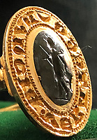 BNPS.co.uk (01202)558833<br /> Pic:   Hansons/BNPS<br /> <br /> A 81-year-old metal detectorist has rediscovered a rare ancient gold ring worth £10,000 - 40 years after initially finding it.<br /> <br /> Tom Clark first unearthed the seal ring in the early 1980s but put it in a tin in his mum's garage when he was told it was modern and of little value.<br /> <br /> He had forgotten all about the find until he started clearing out the garage, where he found it tucked away. <br /> <br /> Tom took it to an auctioneers who identified it as a medieval seal ring that would have belonged an import person in the 14th century.<br /> <br /> He has now decided to sell it after being told it could be worth £10,000.