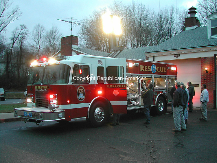 PLYMOUTH, CT - 25 Nov. 2008 - 112508KM01 - Terryville firefighters test the light tower of their new rescue truck at the fire house. The truck was delivered Tuesday afternoon. It was purchased for $380,000, including a $25,000 trade in for the old rescue truck, which the department bought in 1986. The truck was custom built by Rescue 1 in New Jersey. Firefighters said the new truck has more room for rescue equipment and is lower to the ground, making it safer for them to get in and out of the vehicle. The light tower, which the old truck did not have, provides rescue personnel adequate lighting at the scene of accidents and other incidents. The new truck also comes equipped with a Jaws of Life device, allowing the department to transfer a portable extrication device from the old truck to the Fall Mountain fire house. That means all three fire companies in town now have an extrication device, commonly used to cut open vehicles to remove passengers from vehicles in bad car accidents. Kurt Moffett Republican-American