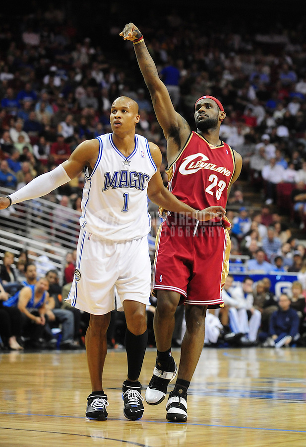 Feb. 11, 2008; Orlando, FL, USA; Cleveland Cavaliers forward LeBron James (23) follows through on a shot as Orlando Magic guard Maurice Evans looks on at Amway Arena Mandatory Credit: Mark J. Rebilas-