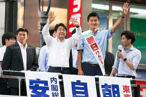 (L to R) Shinzo Abe, leader of the Liberal Democratic Party and Prime Minister of Japan, and Kentaro Asahi, former beach volleyball star and LDP candidate, greet supporters during a campaign event in Shibuya on July 3, 2016, Tokyo, Japan. Abe came to support Asahi's campaign for July 10th's House of Councillors elections. (Photo by Rodrigo Reyes Marin/AFLO)
