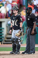 Quad Cities River Bandits catcher Brian Holberton (10) and umpire Christopher Lloyd during a game against the Kane County Cougars on August 14, 2014 at Third Bank Ballpark in Geneva, Illinois.  Kane County defeated Quad Cities 4-1.  (Mike Janes/Four Seam Images)