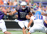SIOUX FALLS, SD - SEPTEMBER 5: Luke Papilion #15 from the University of Sioux Falls looks for room around Preston Tescher #30 from the University of Mary in the first half of their game Saturday afternoon at Bob Young Field.  (Photo by Dave Eggen/Inertia)