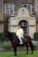 Portrait of Detmar Blow on his horse in front of his family home in The Cotswolds