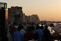 Crowds as prayer is called on the waterfront in Dubai.