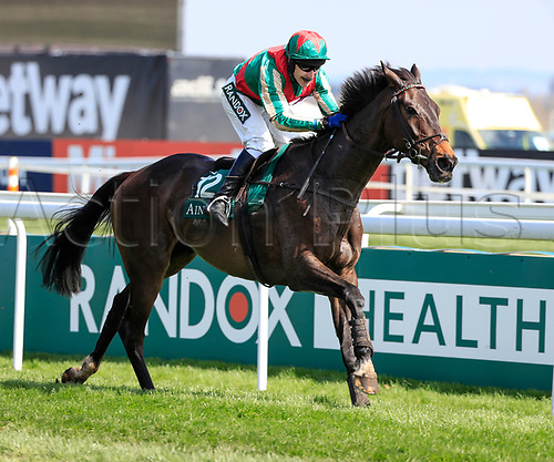 14h April 2018, Aintree Racecourse, Liverpool, England; The 2018 Grand National horse racing festival sponsored by Randox Health, day 3; Tom Scudamore on Mr Big Shot runs on to win The Gaskells Handicap Hurdle