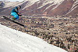 USA, Colorado, Aspen, skiing a run called Norway with the town of Aspen in the distance, Aspen Ski Resort, Ajax mountain