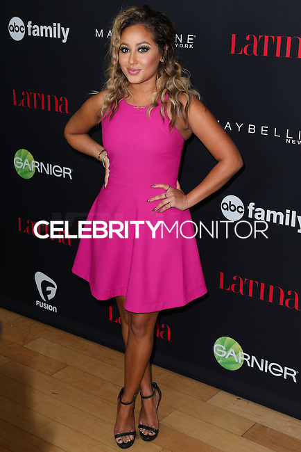 WEST HOLLYWOOD, CA, USA - NOVEMBER 13: Adrienne Bailon arrives at the Latina Magazine's '30 Under 30' Party held at SkyBar at the Mondrian Los Angeles on November 13, 2014 in West Hollywood, California, United States. (Photo by Xavier Collin/Celebrity Monitor)