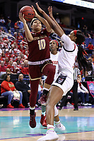 GREENSBORO, NC - MARCH 07: Makayla Dickens #10 of Boston College is defended by Jada Boyd #5 of North Carolina State University during a game between Boston College and NC State at Greensboro Coliseum on March 07, 2020 in Greensboro, North Carolina.