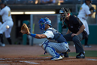 Lexington Legends catcher MJ Melendez (7) waits for the pitch to arrive as home plate umpire Kelvis Velez looks on during the game against the West Virginia Power at Appalachian Power Park on June 7, 2018 in Charleston, West Virginia. The Power defeated the Legends 5-1. (Brian Westerholt/Four Seam Images)