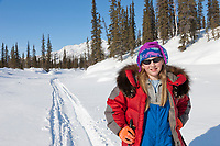 Julia hicker, cross country skiing along Wiseman creek, Brooks Range, Arctic, Alaska.