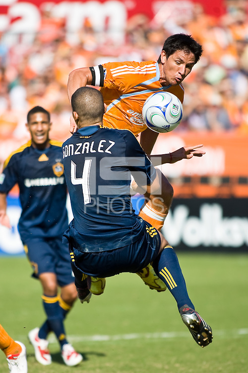 Houston Dynamo forward Brian Ching (25) attempts to get the ball past Los Angeles Galaxy defender Omar Gonzalez (4) and into the goal. Houston Dynamo tied Los Angeles Galaxy 0-0 at Robertson Stadium in Houston, TX on October 18, 2009.