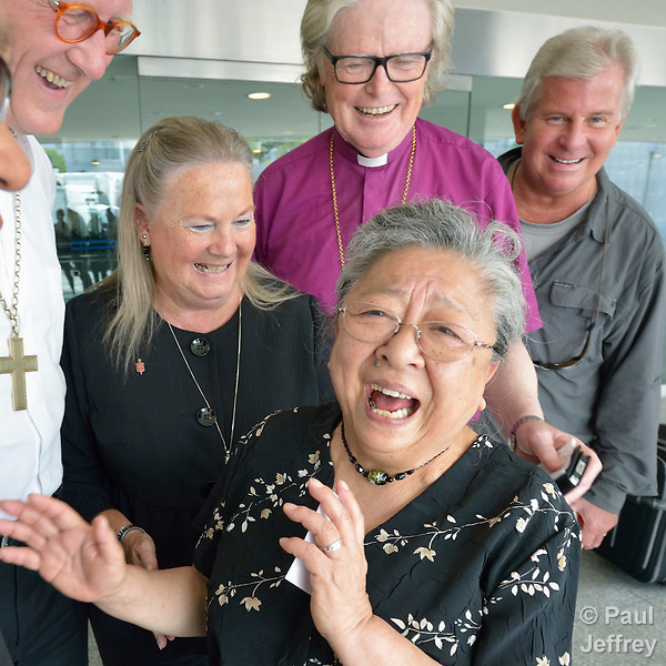 Koko Kondo, a survivor of the 1945 atom bomb dropped on Hiroshima, Japan, laughs on August 7, 2015, as she talks with a delegation of church leaders from around the world who have come to see for themselves the suffering caused by the bomb, to listen to the survivors and to local church leaders, and to return home recommitted to advocating for an end to nuclear weapons. The delegation of pilgrims was organized by the World Council of Churches. Kondo is a well-known hibakusha, or atom bomb survivor, who along with her father is mentioned in John Hershey's landmark book about the horror of Hiroshima.