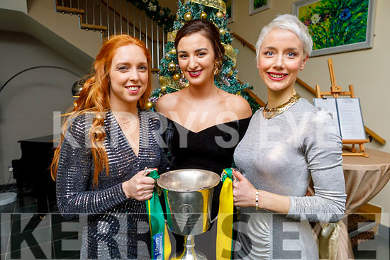 Patrice Diggins, Niamh Leen and Olivia Dineen holding the All Ireland Junior Cup at   the Kerry and Clanmaurice Camogie Awards Night in the Ballyroe Heights Hotel on Sunday.