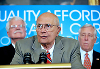 Washington, DC - July 14, 2009 -- U.S. Representative John D. Dingell (Democrat of Michigan), Chairman Emeritus, U.S. House Committee on Energy and Commerce, makes remarks as he and fellow Democratic members of the U.S. House of Representatives to unveil the America's Affordable Health Choice Act of 2009 during a press conference in the Rayburn Room of the U.S. Capitol on Tuesday, July 14, 2009.  Behind Dingell are U.S. Representative George Miller (Democrat of California), left, and House Majority Leader Steny Hoyer (Democrat of Maryland), right. Credit: Ron Sachs/CNP/AdMedia