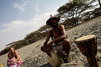 Alex, A french Rastafrarian with origins from Guadalupe plays his bongo on the shores of lake Langano, the closest water front from Shashamane, where a comunity of 300 Rastafarian families live, in Ethiopia on Thursday March 20th 2008.///..The Rastafarians, who are mainly from Jamaica, started migrating to Ethiopia 45 years ago, when Haile Selassie, whom they consider to be God incarnate, gave them 500 hectares of land on which to settle..Since the first 12 Jamaican settlers in 1963, the community has grown to over 200 families..The Rastafarian community insists that a mass exodus of Jamaicans to Ethiopia would not be a burden, despite the poverty and economic difficulties faced in the country..Some of them are skilled tradesmen such as carpenters and builders..Others are shop owners and they say that over the decades they have played an important role in the development of Shashamene..In January 2005 there were reports in the media that Bob marley's remains were to be exhumed and then reburied at Shashamane. His wife Rita Marley described Ethiopia as his spiritual home, provoking controversy in Jamaica, where his remains lie..At the beginning of the following month, thousands of fans gathered in Shashamane for a month of celebrations for what would have been Marley's 60th birthday. Until 2005 his birthday celebrations were always held in Jamaica. These events brought Shashamane to wider prominence throughout the world..
