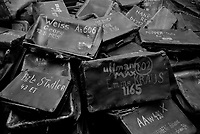 Auschwitz / Poland 2011.Battered suitcases sit in a heap in a room at Auschwitz I, the largest Nazi extermination camp in operation during World War II. The cases, most inscribed with each owner's name, were taken from prisoners upon their arrival at the camp..Photo Livio Senigalliesi