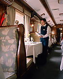 PERU, Cusco, South America, Latin America, waitress holding menu in Hiram Bingham train