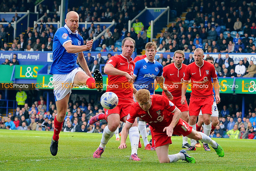 Bradley Halliday of York City heads the ball away from the foot of Jonannes Ertl of Portsmouth - Portsmouth vs York City - Sky Bet League Two Football at Fratton Park, Portsmouth, Hampshire - 02/05/15 - MANDATORY CREDIT: Denis Murphy/TGSPHOTO - Self billing applies where appropriate - contact@tgsphoto.co.uk - NO UNPAID USE