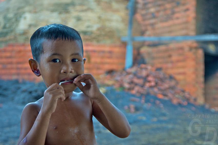 Portrait of a boy in rural area near a brick kiln, Battambang Cambodia