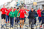 Garda Aidan O'Mahony carrying the Special Olympics torch into the Mall on Monday afternoon.