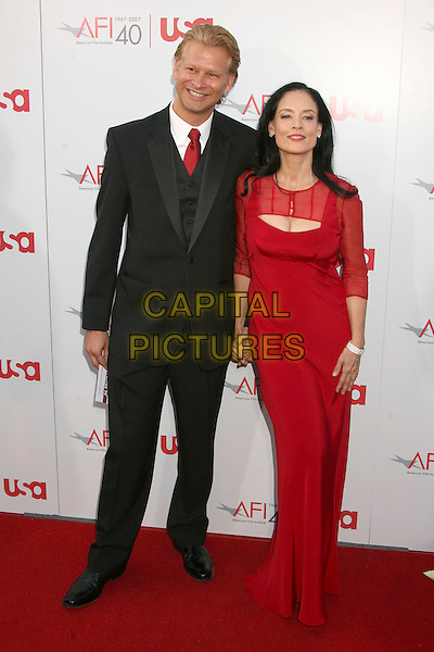 SONIA BRAGA & GUEST.35th Annual AFI Life Achievement Award Honoring Al Pacino at the Kodak Theatre, Hollywood, California, USA.7 June 2007..full length red dress.CAP/ADM/BP.©Byron Purvis/AdMedia/Capital Pictures.