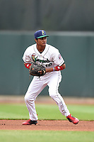 Cedar Rapids Kernels shortstop Jermaine Palacios (16) throws to first during the first game of a doubleheader against the Kane County Cougars on May 10, 2016 at Perfect Game Field in Cedar Rapids, Iowa.  Kane County defeated Cedar Rapids 2-0.  (Mike Janes/Four Seam Images)